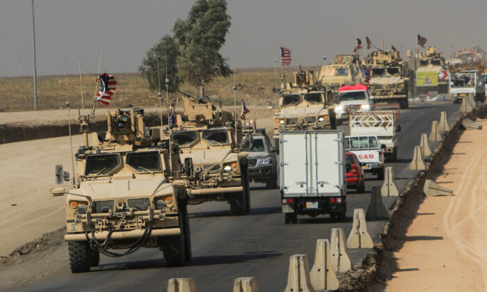 A convoy of U.S. vehicles is seen after withdrawing from northern Syria, on the outskirts of Dohuk, Iraq on Oct. 21, 2019. (Ari Jalal/Reuters)