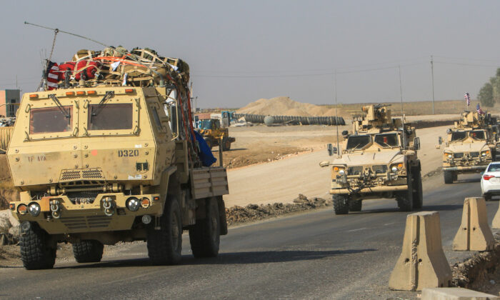 A convoy of U.S. vehicles is seen after withdrawing from northern Syria, on the outskirts of Dohuk, Iraq, on Oct 21, 2019. (Ari Jalal/Reuters)