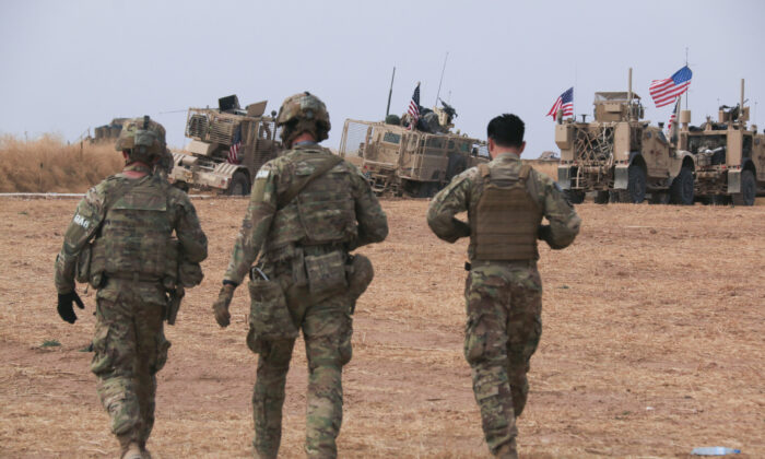 An American military convoy stops near the town of Tel Tamr, north Syria on Oct. 20, 2019. (AP Photo/Baderkhan Ahmad)