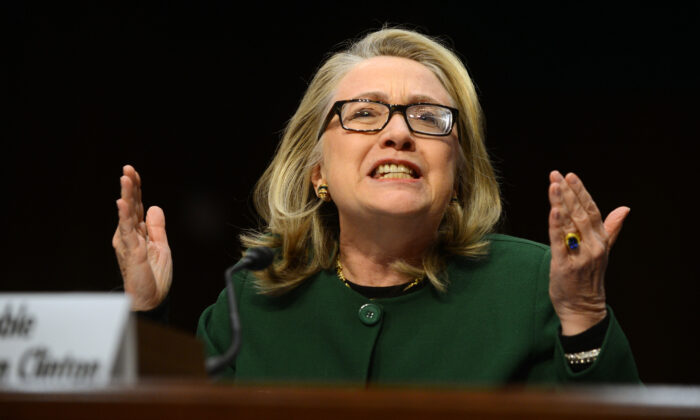 Then-Secretary of State Hillary Clinton testifies before the Senate Foreign Relations Committee on the September 11, 2012 attack on the US mission in Benghazi, Libya, during a hearing on Capitol Hill in Washington on Jan. 23, 2013. (SAUL LOEB/AFP/Getty Images)