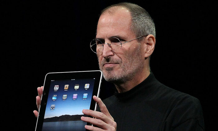 Apple Inc. CEO Steve Jobs holds up the new iPad as he speaks during an Apple Special Event at Yerba Buena Center for the Arts  in San Francisco, Calif., on Jan. 27, 2010. (Justin Sullivan/Getty Images)