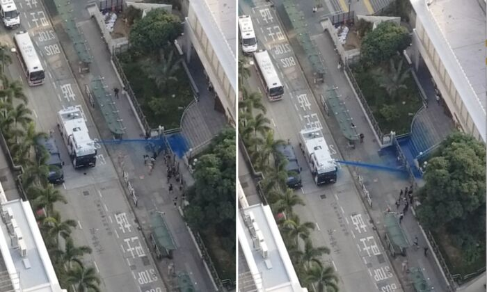 Camera equipped on The Epoch Times' drone captures the moment police fired a water cannon at the Kowloon Masjid and Islamic Center with blue dye when a few people were standing in front of the mosque on Oct. 20, 2019. (The Epoch Times)