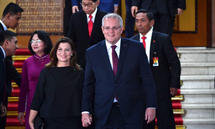 Australia's Prime Minister Scott Morrison and his wife Jenny (L) leave after the inauguration of Indonesia's President Joko Widodo for a second term, at the parliament building in Jakarta on Oct. 20, 2019. (ADEK BERRY/POOL/AFP via Getty Images)