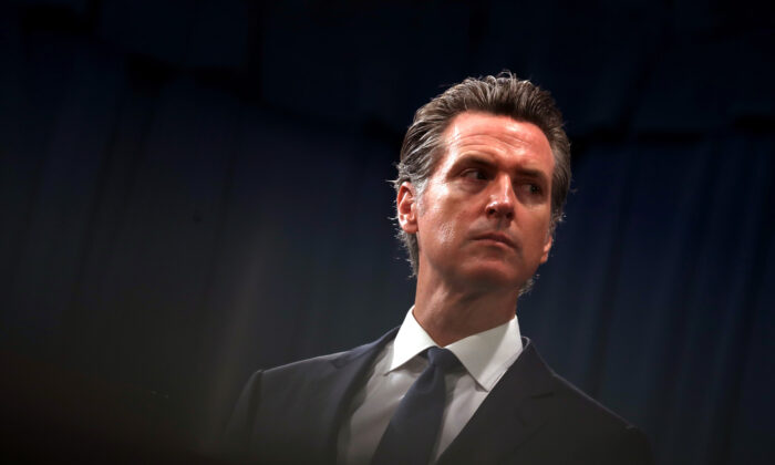 California Gov. Gavin Newsom looks on during a news conference in Sacramento on Aug. 16, 2019. (Justin Sullivan/Getty Images)