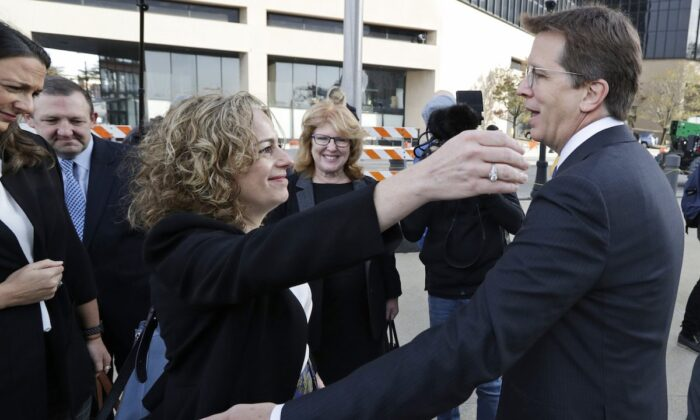 Attorneys Linda Singer and Mark Lanier hug outside the Federal courthouse in Cleveland, Ohio, on Oct. 21, 2019. (Tony Dejak/AP Photo)