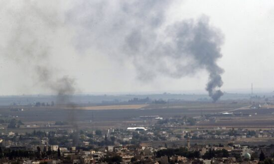 Kurdish-Led Forces Say They Have Pulled out of Syria Border Town