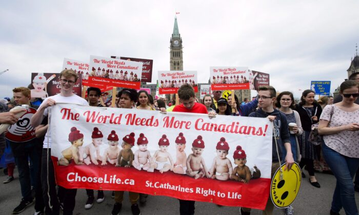 Pro-life advocates take part in the March for Life on Parliament Hill in Ottawa on May 10, 2018. (THE CANADIAN PRESS/Sean Kilpatrick)