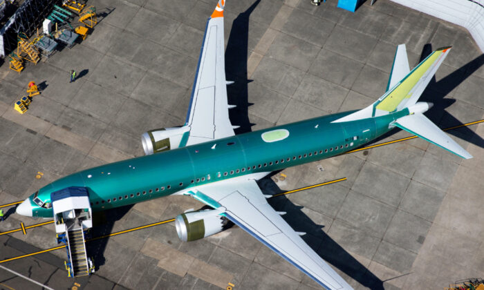 An unpainted Boeing 737 MAX aircraft is seen parked in an aerial photo at Renton Municipal Airport near the Boeing Renton facility in Renton, Washington, U.S. July 1, 2019. (Lindsey Wasson/Reuters)
