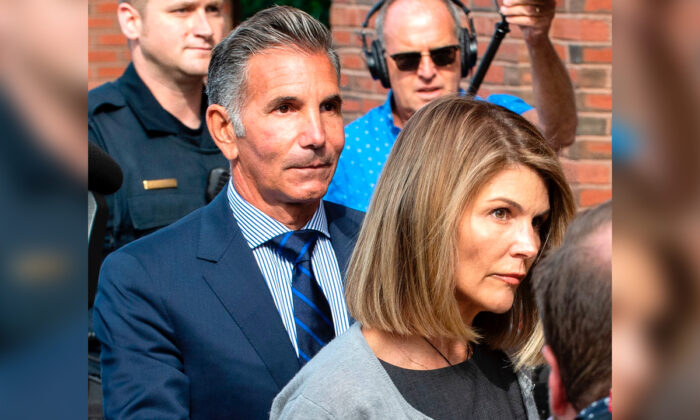 Actress Lori Loughlin and husband Mossimo Giannulli exit the Boston Federal Court house after a pre-trial hearing with Magistrate Judge Kelley at the John Joseph Moakley U.S. Courthouse in Boston on Aug. 27, 2019. (Joseph Prezioso/AFP/Getty Images)
