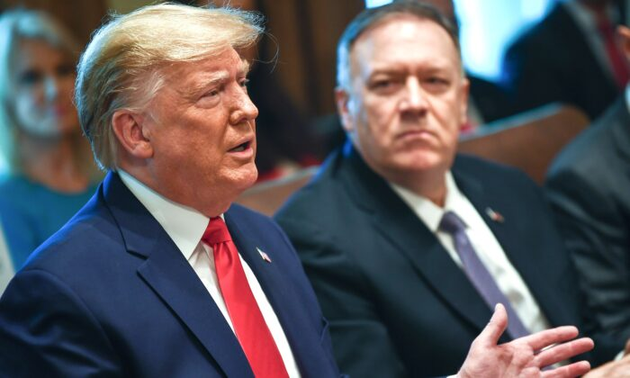 President Donald Trump(L) speaks next to Secretary of State Mike Pompeo during a Cabinet Meeting at the White House on Oct. 21, 2019. (Brendan Smialowski/AFP via Getty Images)