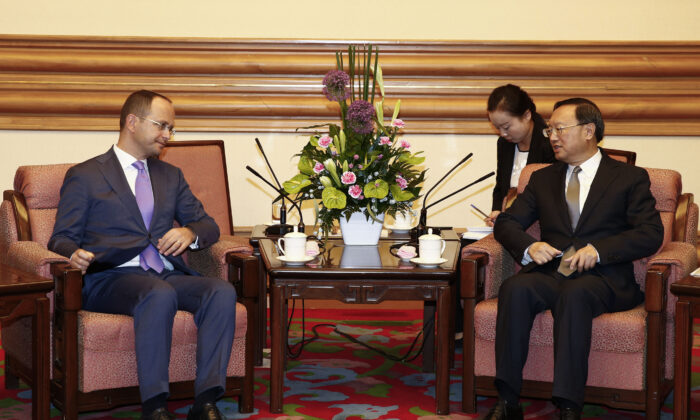 Albania Foreign Minister Ditmir Bushati  (L) and Chinese State Councilor Yang Jiechi (R) hold a meeting at the Zhongnanhai Leadership Compound in Beijing, China on Aug. 26, 2016. The two officials are meeting to boost bilateral ties between the two countries. (Rolex Dela Pena-Pool/Getty Images)
