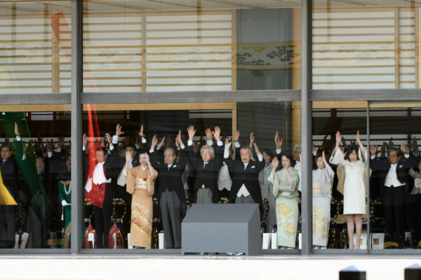 Japanese dignitaries and government representatives raise their arms giving a banzai cheer during the enthronement ceremony of Japan's Emperor Naruhito at the Imperial Palace in Tokyo