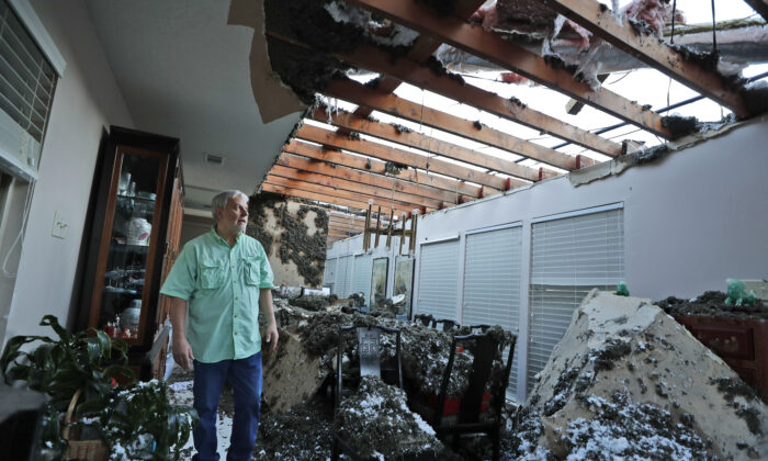 Tracy Wallace looks at his missing roof after his home was hit by a tornado on Oct. 21, 2019 in Richardson, Texas. (AP Photo/LM Otero)