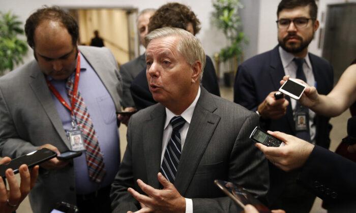Senate Judiciary Chairman Lindsey Graham (R-S.C.) speaks with members of the media on Capitol Hill in Washington on Oct. 22, 2019. (Patrick Semansky/AP Photo)