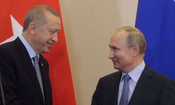 Russian President Vladimir Putin (R) and his Turkish counterpart Recep Tayyip Erdogan shake hands during a joint press conference following their talks in the Black sea resort of Sochi on Oct. 22, 2019. (Sergei Chirikov/AFP via Getty Images)