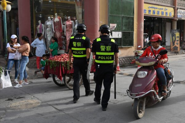Police officers patrolling in Kashgar City, Xinjiang, China, on June 4, 2019. Authorities in the region have collected DNA samples from residents en masse. (GREG BAKER/AFP/Getty Images)