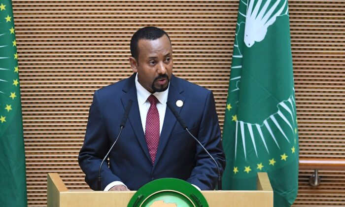 Ethiopia's Prime Minister Abiy Ahmed delivers a speech during the 11th Extraordinary Session of the Assembly of the African Union in Addis Ababa, Ethiopia, on Nov. 17, 2018. (Monirul Bhuiyan/AFP/Getty Images)