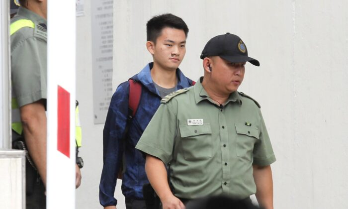 Chan Tong-kai (C), a Hong Kong citizen who was accused of murdering his girlfriend in Taiwan last year, walks as he is released from prison in Hong Kong on Oct. 23, 2019. (Kin Cheung/AP Photo)