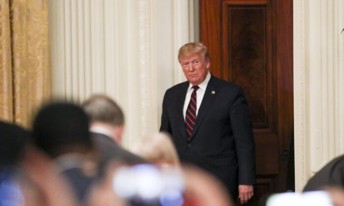 President Donald Trump enters the East Room of the White House in Washington on Oct. 16, 2019. (Charlotte Cuthbertson/The Epoch Times)