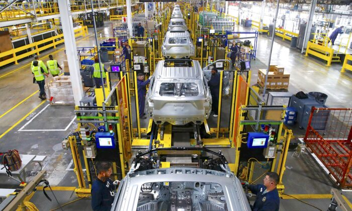 Workers assemble cars at the newly renovated Ford's Assembly Plant in Chicago on June 24, 2019.  (Jim Young/AFP/Getty Images)