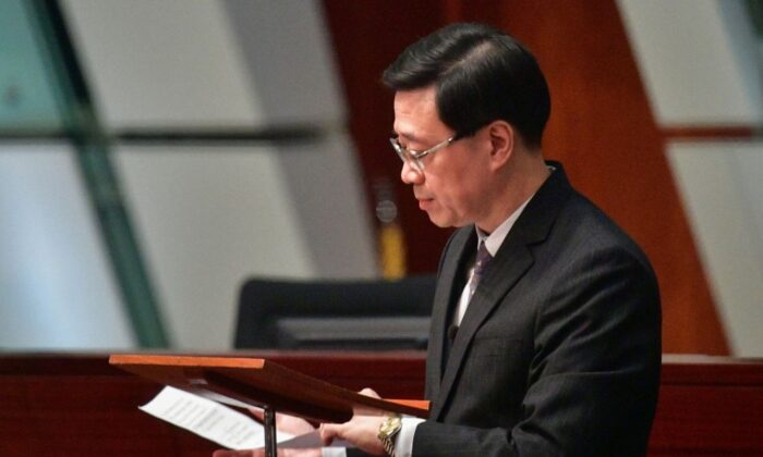 Hong Kong Secretary for Security John Lee lowers his notes after officially withdrawing the extradition bill at the Legislative Council complex in Hong Kong on Oct. 23, 2019. (Anthony Wallace/AFP via Getty Images)