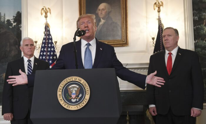 President Donald Trump speaks about Syria, next to US Vice President Mike Pence (L) and US Secretary of State Mike Pompeo in the Diplomatic Reception Room at the White House on Oct. 23, 2019. (Saul Loeb/AFP via Getty Images)