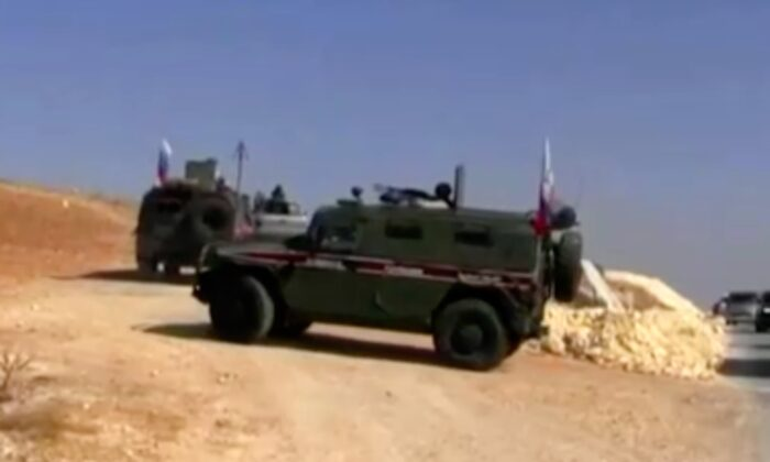 Various Russian military police convoys, including vehicles with Russian flags, drive through Kobani, Syria on Oct. 23, 2019. (Video screenshot/K24 via Reuters)