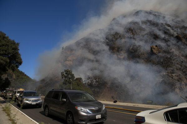 residents flee as a wildfire erupts