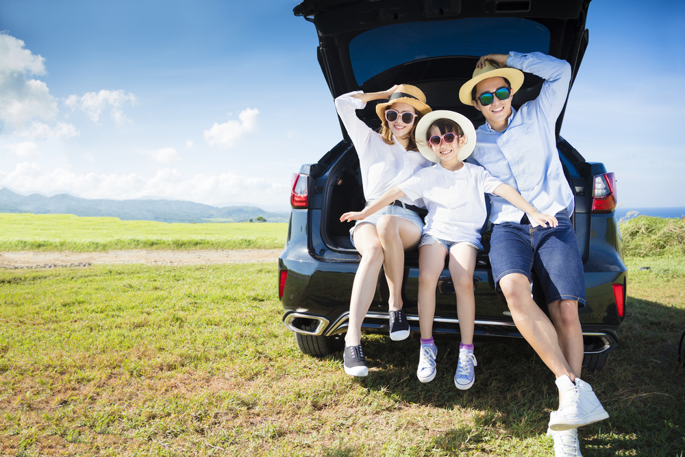 happy family enjoying road trip