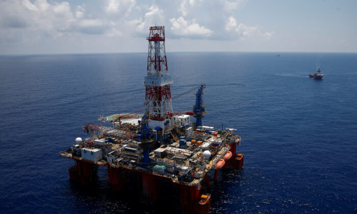 A general view shows JDC Hakuryu-5 drilling rig and supply vessels in the South China Sea off the coast of Vung Tau, Vietnam on April 29, 2018. (Maxim Shemetov/Reuters)