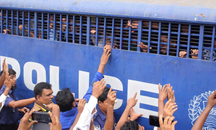 Accused people are seen inside a prison van after they were given death sentences in a murder case in Feni, Bangladesh on Oct. 24, 2019. (Stringer/Reuters)