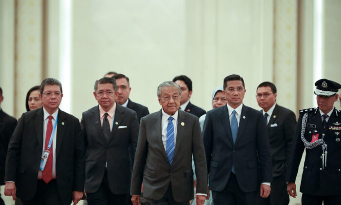 Malaysia Prime Minister Mahathir Mohamad (C) arrives to take part in the second Belt and Road Forum (BRF) and meet with President of the People's Republic of China Xi Jinping at the Great Hall of People in Beijing on April 25, 2019. (Andrea Verdelli/AFP/Getty Images)