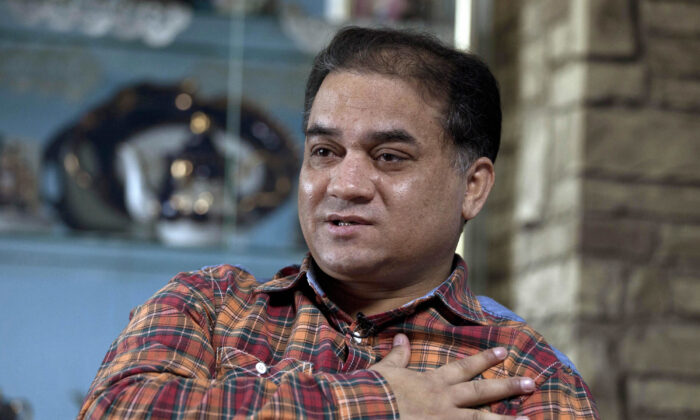 Ilham Tohti, an outspoken scholar of China's Turkic Uyghur ethnic minority, speaks during an interview at his home in Beijing, China on Feb. 4, 2013. (Andy Wong/AP)