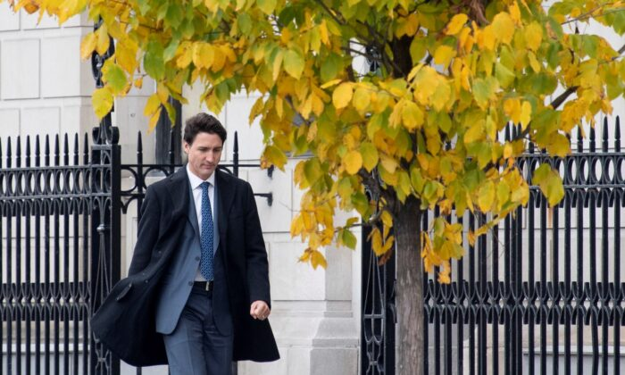 Prime Minister Justin Trudeau walks to his first news conference since being re-elected on Oct. 23, 2019 in Ottawa. (The Canadian Press/Adrian Wyld)
