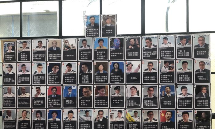 Photos of Hong Kong officials who lied to the public are displayed at the Oct. 20  exhibition. (Nathan Su/The Epoch Times)