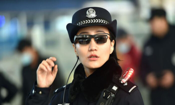 A police officer wearing a pair of smart glasses fitted with a facial recognition system at the Zhengzhou East Railway Station in Zhengzhou City, in China's central Henan Province on Feb. 5, 2018. (AFP/Getty Images)