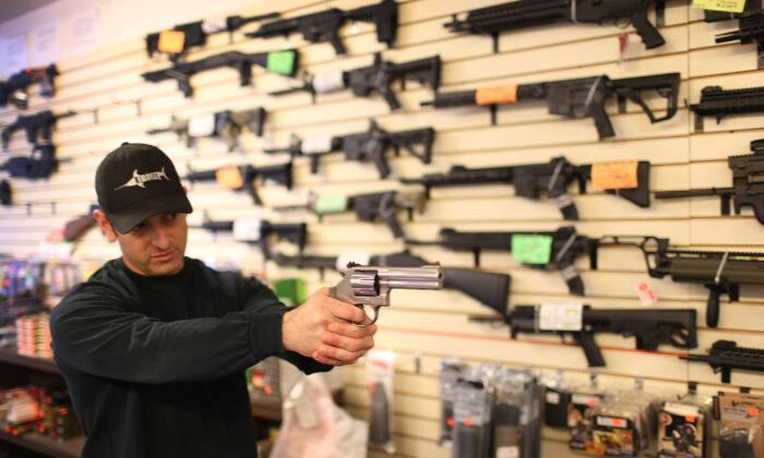 A salesman shows a customer a handgun in Delray Beach, Florida, on Jan. 5, 2016.  (Joe Raedle/Getty Images)