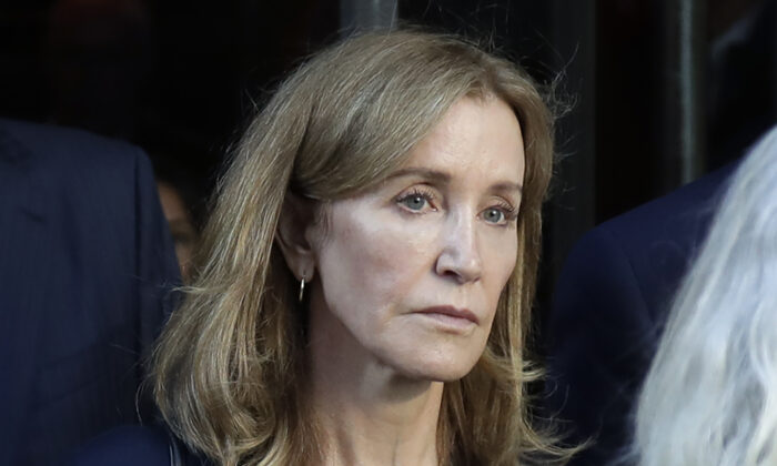 Actress Felicity Huffman leaving federal court after her sentencing in a nationwide college admissions bribery scandal in Boston on Sept. 13, 2019. (AP Photo/Elise Amendola, File)