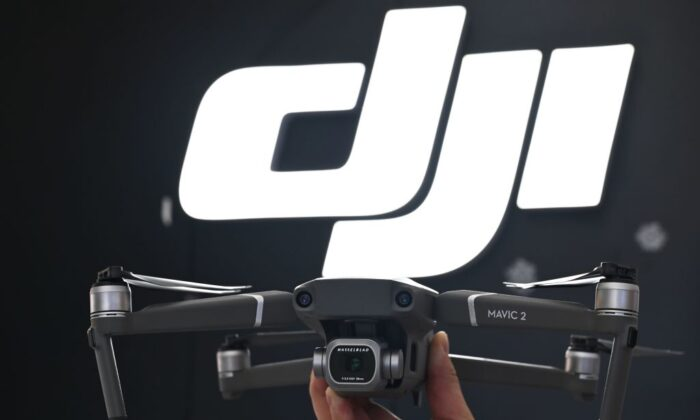 An employee shows the new Mavic Pro 2 drone in a DJI store in Shanghai on May 22, 2019. (Hector Retamal/AFP/Getty Images)