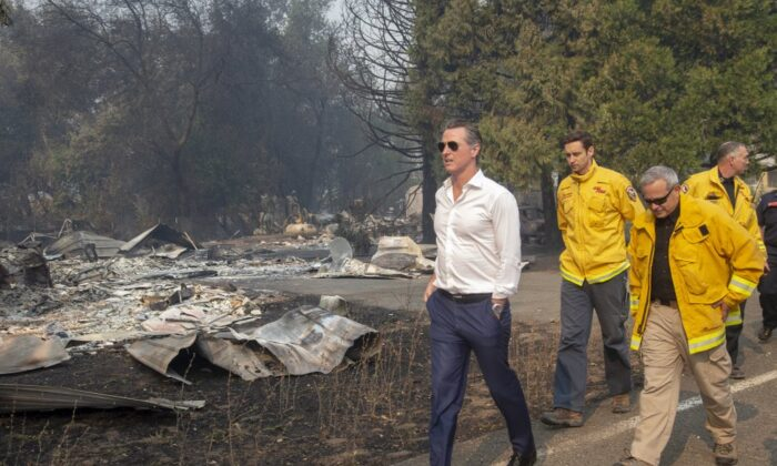 California Gov. Gavin Newsom (L), tours a home destroyed by the Kincade fire in Geyserville, Calif. on Oct. 25, 2019. (Karl Mondon/San Jose Mercury News via AP)