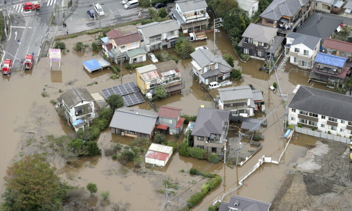 A flooded residential area after a heavy rain is seen in Sakura, Chiba prefecture, east of Tokyo, Japan on Oct. 26, 2019. (Kyodo/via Reuters)