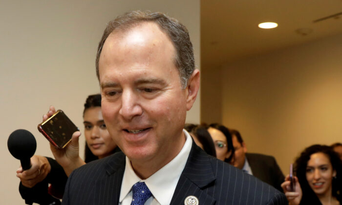 House Intelligence Committee Chairman Rep. Adam Schiff (D-Calif.) leaves a secure area where Deputy Assistant Secretary of Defense Laura Cooper is testifying as part of the House impeachment inquiry into President Donald Trump on Capitol Hill in Washington on Oct. 23, 2019. (AP Photo/Patrick Semansky)