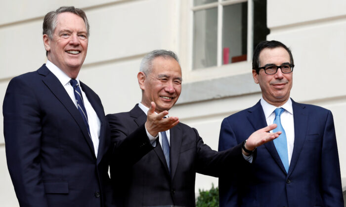 China's Vice Premier Liu He gestures to the media between U.S. Trade Representative Robert Lighthizer (L) and Treasury Secretary Steve Mnuchin before the two countries' trade negotiations in Washington, on Oct. 10, 2019. (Yuri Gripas/Reuters)