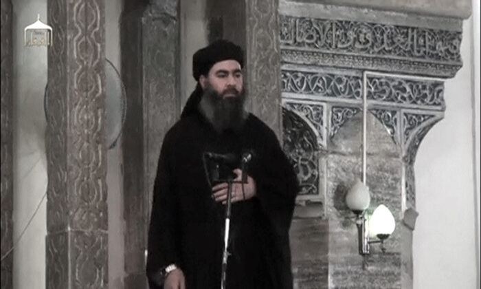 A man purported to be the reclusive leader of the extremist group ISIS Abu Bakr al-Baghdadi has made what would be his first public appearance at a mosque in the centre of Iraq's second city, Mosul, according to a video recording posted on the Internet on July 5, 2014, in this still image taken from video. (Social Media Website via Reuters TV/File Photo)