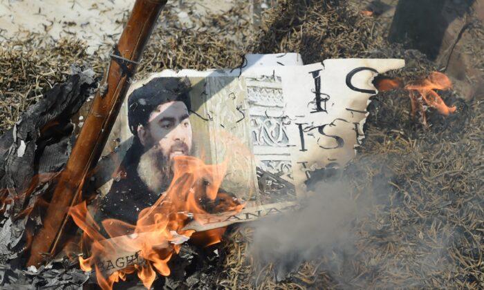 Demonstrators burn an effigy of the ISIS leader Abu Bakr al-Baghdadi during a protest in New Delhi on June 9, 2017. (Prakash Singh/AFP/Getty Images)