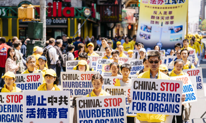 Falun Dafa Day parade in Manhattan, New York City, on May 16, 2019. (Edward Dye/The Epoch Times)