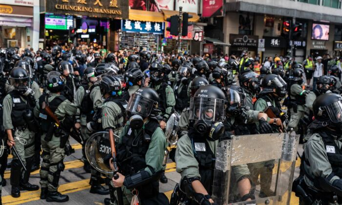 Riot police stand guard on a street outside of Chung King Mansions in Tsim Sha Tsui district in Hong Kong, China on October 27, 2019. (Anthony Kwan/Getty Images)