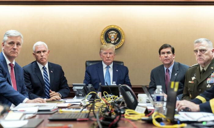 President Donald Trump is joined by Vice President Mike Pence, national security adviser Robert O'Brien (L), Secretary of Defense Mark Esper, and Chairman of the Joint Chiefs of Staff Army Gen. Mark A. Milley (R)  in the Situation Room of the White House on Oct. 26, 2019. (Shealah Craighead/White House via AP)