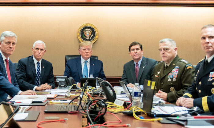 Pictured in the photo with the president was Vice President Mike Pence, National Security Advisor Robert O'Brien, Secretary of Defense Mark Esper, Chairman of the Joint Chiefs of Staff U.S. Army General Mark A. Milley, and Deputy Director for Special Operations Brig. Gen. Marcus Evans. (White House)