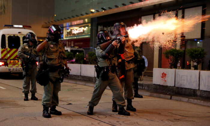 A riot police officer fires a pro-democracy demonstrators during a protest in Hong Kong's tourism district of Tsim Sha Tsui, China on Oct. 27, 2019. (Ammar Awad/Reuters)